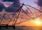 sunset over chinese fishing nets and boat in cochin kochi kerala india 1600x968